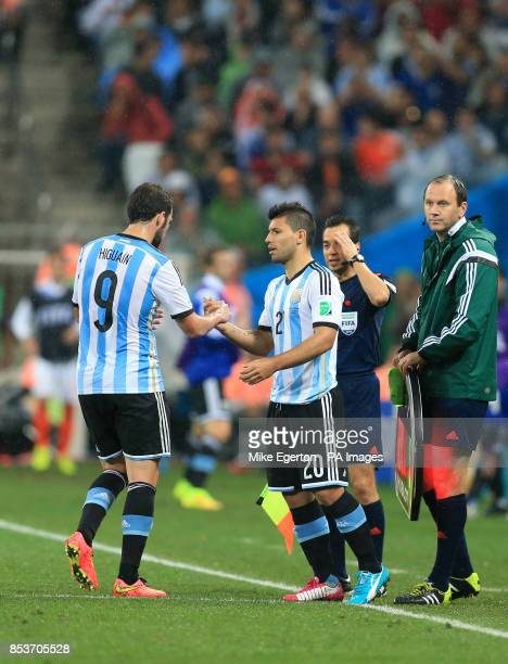 Argentina's Gonzalo Higuain is substituted for Argentina's Sergio Aguero