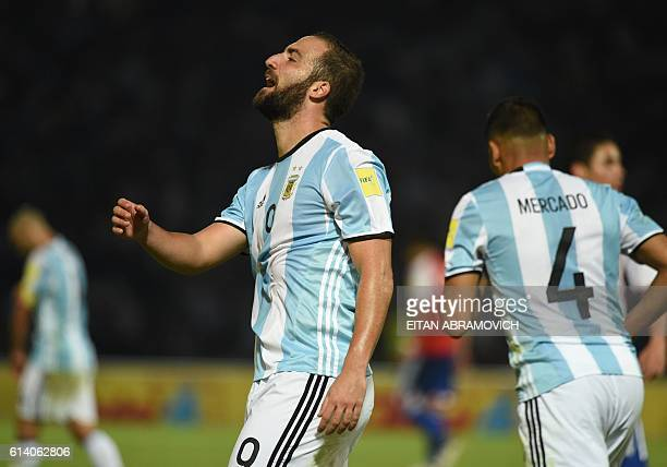 Argentina's Gonzalo Higuain reacts in dejection after failing a shot during a Russia 2018 World Cup football qualifier match against Paraguay in...