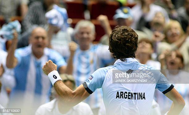 Argentina's Guido Pella reacts after winning the tennis match against Poland's Michal Przysiezny at the Davis Cup World Group first round between...