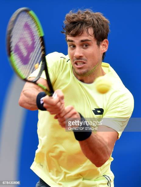 Argentina's Guido Pella returns the ball during his round of sixteen tennis match against Italy's Fabio Fognini at the ATP tennis BMW Open in Munich...