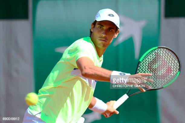 Argentina's Guido Pella returns the ball to Argentina's Juan Martin del Potro during their tennis match at the Roland Garros 2017 French Open on May...