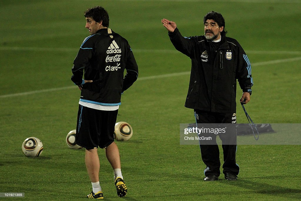 Argentina's head coach Diego Maradona talks with <a gi-track='captionPersonalityLinkClicked' href=/galleries/search?phrase=Diego+Milito&family=editorial&specificpeople=689963 ng-click='$event.stopPropagation()'>Diego Milito</a> during a team training session on June 9, 2010 in Pretoria, South Africa.