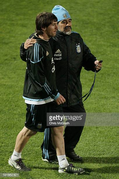 Argentina's head coach Diego Maradona talks with Lionel Messi at the completion of a team training session on June 10 2010 in Pretoria South Africa