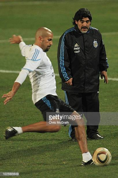 Argentina's head coach Diego Maradona watches on as Juan Veron takes a shot at goal during a team training session on July 1 2010 in Pretoria South...