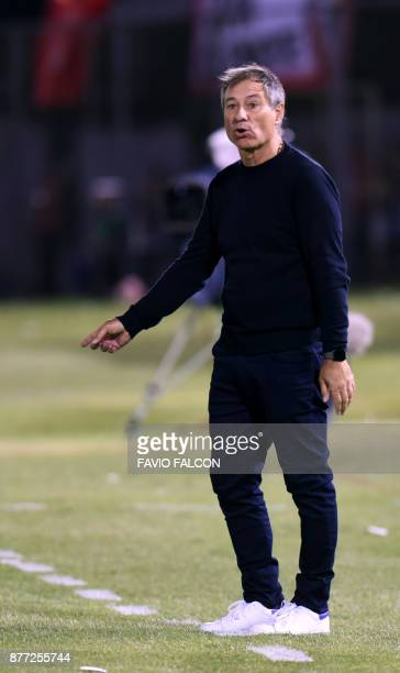 Argentina's Independiente Avellaneda coach Ariel Holan gestures during their Copa Sudamericana first leg semifinal football match against Paraguay's...