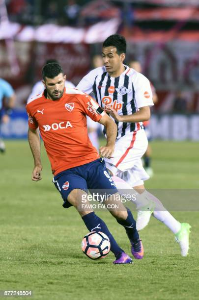 Argentina's Independiente de Avellaneda Emmanuel Gigliotti vies for the ball with Paraguay's Libertad Luis Cardozo during their Copa Sudamericana...