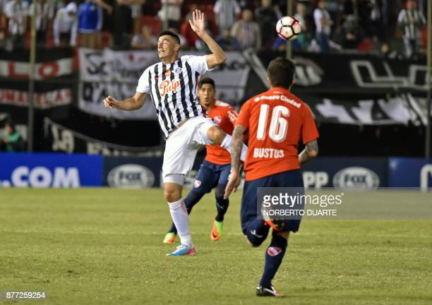 Argentina's Independiente de Avellaneda Fabricio Bustos runs for a ball during their Copa Sudamericana first leg semifinal football match against...