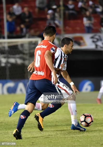 Argentina's Independiente de Avellaneda Juan Sanchez vies for the ball with Paraguay's Libertad Antonio Bareiro during their Copa Sudamericana first...