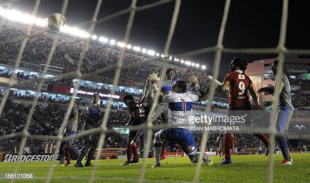 Argentina's Independiente defender Cristian Tula heads the ball to score against Chile's Universidad Catolica during their Copa Sudamericana 2012...