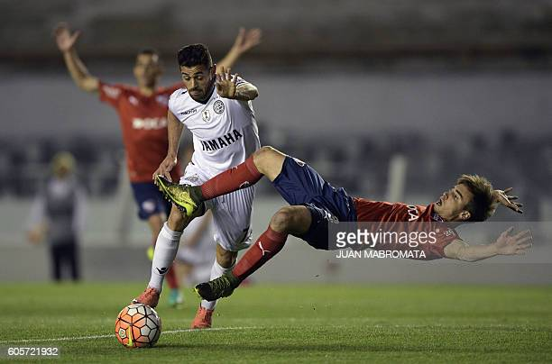 Argentina's Independiente defender Nicolas Tagliafico vies for the ball with Argentina's Lanus forward Lautaro Acosta during their Copa Sudamericana...