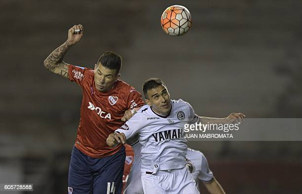 Argentina's Independiente defender Victor Cuesta vies for the ball with Argentina's Lanus defender Maximiliano Velazquez during their Copa...