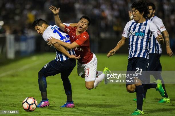 Argentina's Independiente Ezequiel Barco vies for the ball with Alexis Cossio from Peru's Alianza Lima during their Copa Sudamericana football match...