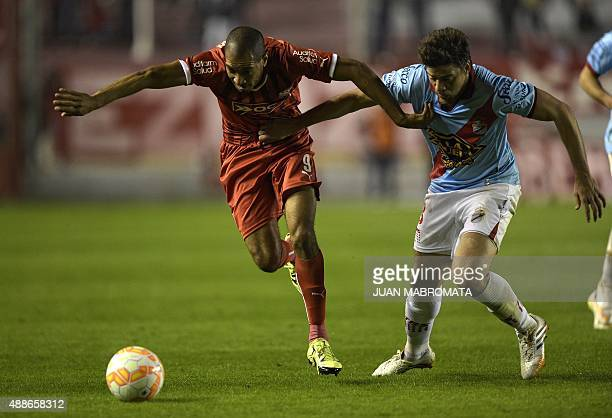Argentina's Independiente forward Diego Vera vies for the ball with Argentina's Arsenal defender Matias Sarulyte during their Copa Sudamericana 2015...