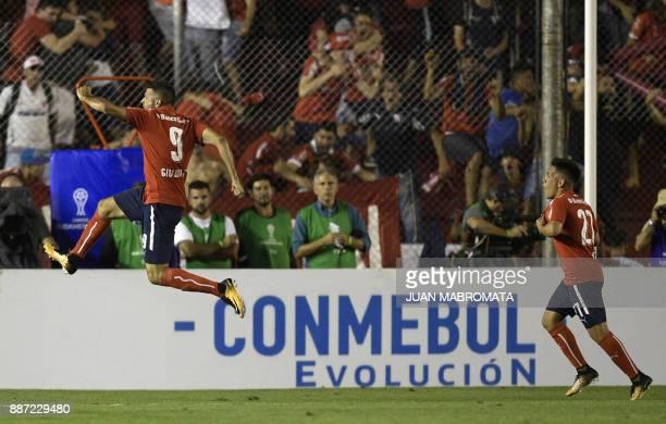 Argentina's Independiente forward Emmanuel Gigliotti celebrates next to teammate midfielder Ezequiel Barco after scoring a goal against Brazil's...