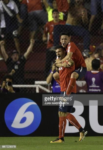 Argentina's Independiente forward Emmanuel Gigliotti celebrates with teammate midfielder Ezequiel Barco after scoring against Brazil's Flamengo...
