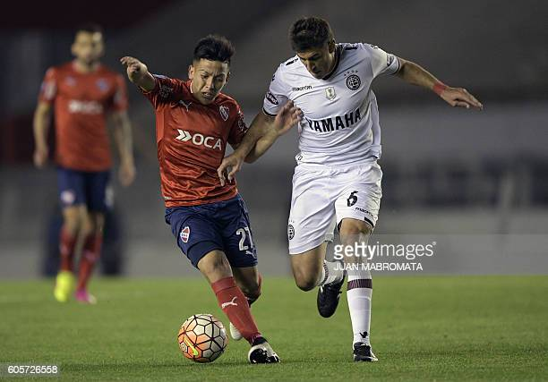 Argentina's Independiente forward Ezequiel Barco vies for the ball with Argentina's Lanus defender Diego Braghieri during their Copa Sudamericana...