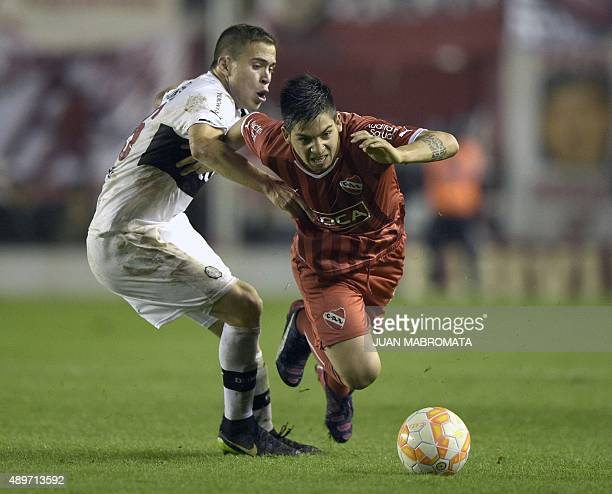 Argentina's Independiente forward Martin Benitez vies for the ball with Paraguay's Olimpia midfielder Robert Piris during their Copa Sudamericana...