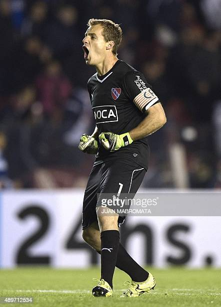 Argentina's Independiente goalkeeper Diego Rodriguez celebrates a goal scored by midfielder Juan Martinez against Paraguay's Olimpia during their...