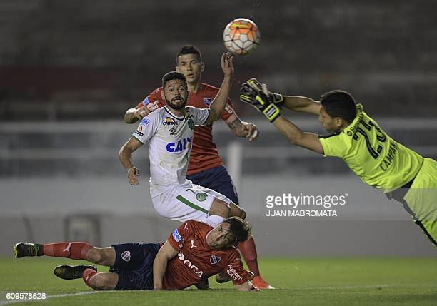 Argentina's Independiente goalkeeper Martin Campana diverts the ball eyed by teammate defender Nicolas Tagliafico and Brazil's Chapecoense midfielder...