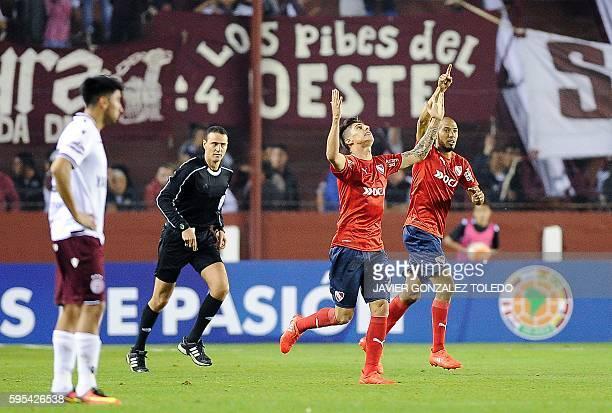 Argentina's Independiente midfielder Emiliano Rigoni celebrates after scoring against Argentina's Lanus during their Sudamericana Cup football match...