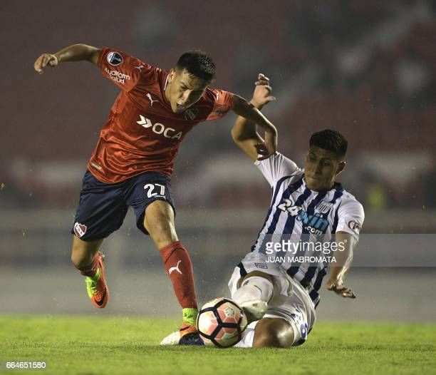 Argentina's Independiente midfielder Ezequiel Barco vies for the ball with Peru's Alianza Lima defender Hansell Riojas during their Copa Sudamericana...