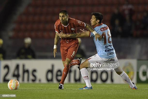 Argentina's Independiente midfielder Jesus Mendez vies for the ball with Argentina's Arsenal midfielder Miguel Caneo during their Copa Sudamericana...