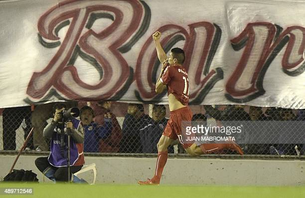 Argentina's Independiente midfielder Juan Martinez celebrates after scoring against Paraguay's Olimpia during the Copa Sudamericana 2015 round before...