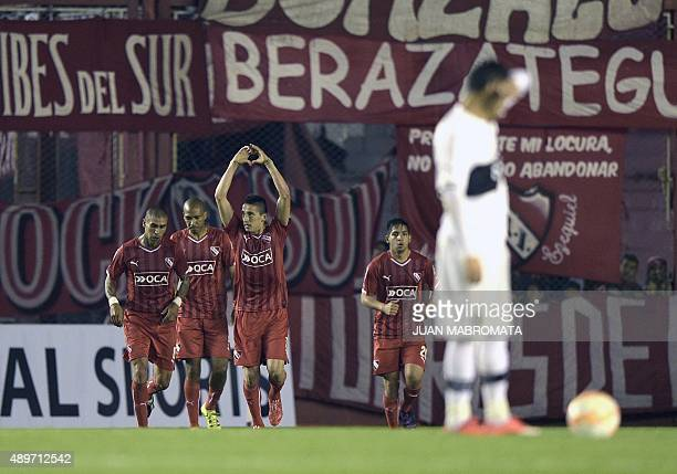 Argentina's Independiente midfielder Juan Martinez celebrates next to teammtes after scoring against Paraguay's Olimpia during the Copa Sudamericana...
