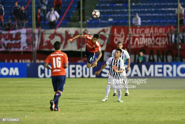 Argentina's Independiente player Maximiliano Meza vies for the ball with Paraguay's Libertad Angel Cardozo during their Copa Sudamericana first leg...