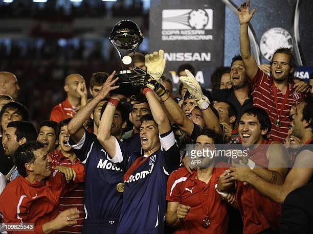 Argentina's Independiente players celebrate with the trophy after winning the Copa Sudamericana 2010 final footbal match after defeating to Brazil's...