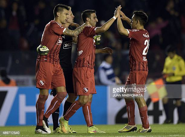 Argentina's Independiente's footballers celebrate after teammate midfielder Juan Martinez scored a goal against Paraguay's Olimpia during the Copa...