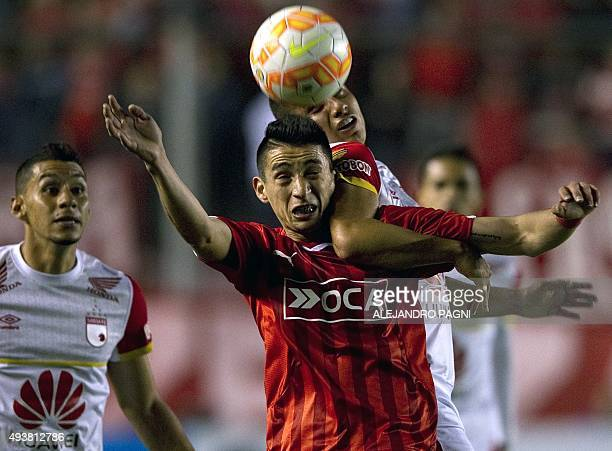 Argentina's Independiente's midfielder Federico Mancuello vies for the ball with Colombia's Independiente Santa Fe's defender Juan Roa during the...