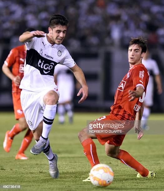 Argentina's Independiente's player Nicolas Tagliafico vies for the ball with Paraguay's Olimpia's player Alejandro Silva during their Copa...