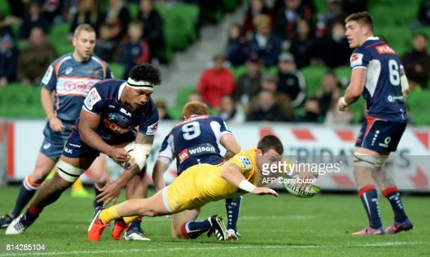 Argentina's Jaguares reserve Gonzalo Bertranou scores a try during the Super Rugby match between Australia's Melbourne Rebels and Argentina's...