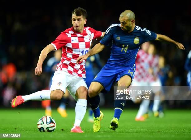 Argentina's Javier Mascherano and Croatia's Anas Sharbini battle for the ball