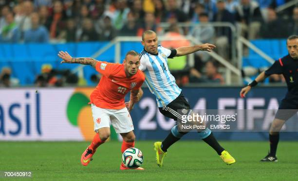 Argentina's Javier Mascherano and Netherland's Wesley Sneijder battle for the ball