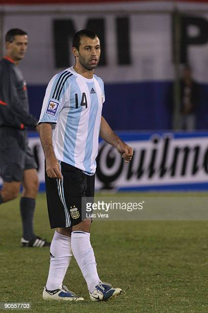 Argentina's Javier Mascherano conducts the ball against Paraguay during their 2010 FIFA World Cup qualifier at the Defensores del Chaco Stadium on...
