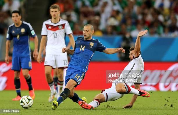 Argentina's Javier Mascherano in action with Germany's Miroslav Klose