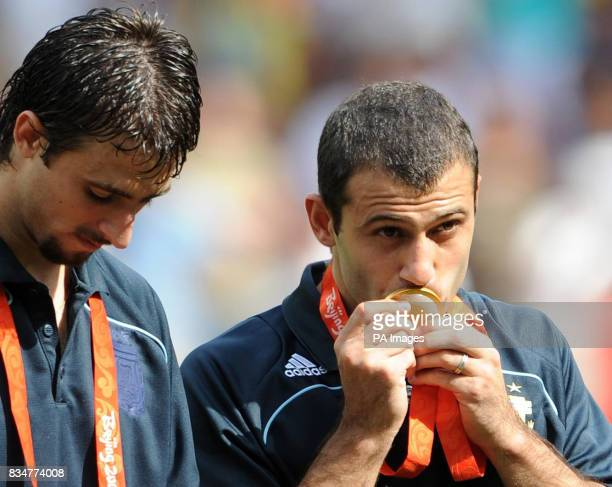 Argentina's Javier Mascherano kisses his Gold Medal for winning the Men's Football competition at the National Stadium during the 2008 Beijing...