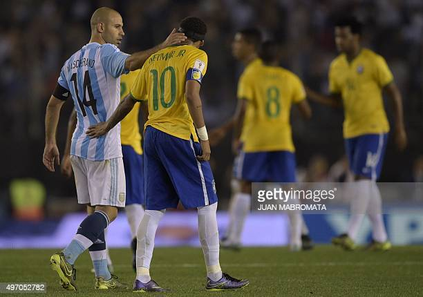 Argentina's Javier Mascherano talks with Brazil's Neymar Jr at the end of the Russia 2018 FIFA World Cup South American Qualifiers football match in...