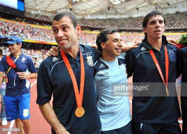 Argentina's Javier Mascherano with his Gold Medal for winning the Men's Football Competition at the National Stadium during the 2008 Beijing Olympic...