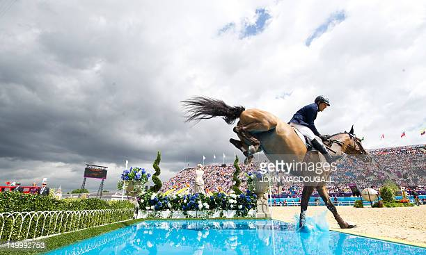 Argentina's Jose Maria Larocca on Royal Power fails to clear the pool in the Individual Show Jumping final of the 2012 London Olympics at the...