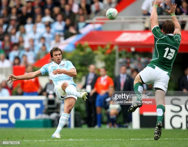 Argentina's Juan Hernandez kicks for goal