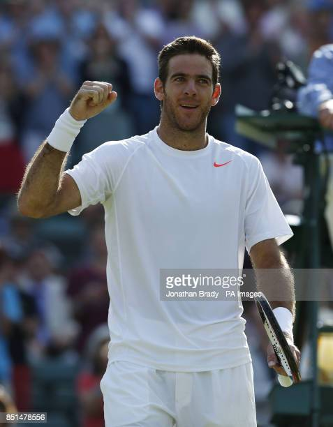 Argentina's Juan Martin Del Potro celebrates defeating Italy's Andreas Seppi during day seven of the Wimbledon Championships at The All England Lawn...