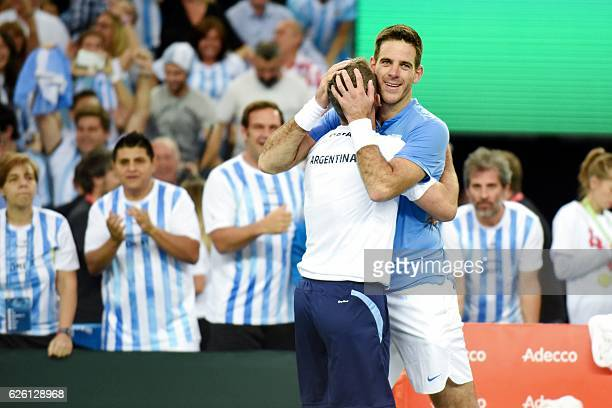 Argentina's Juan Martin del Potro celebrates with his head coach Daniel Orsanic after winning the Davis Cup World Group final singles match between...