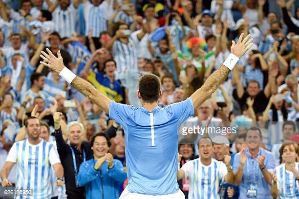TOPSHOT Argentina's Juan Martin del Potro celebrates with supporters after winning the Davis Cup World Group final singles match between Croatia and...