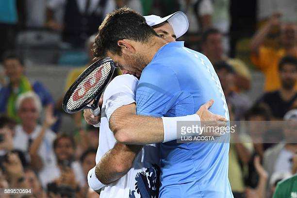 TOPSHOT Argentina's Juan Martin Del Potro congratulates Britain's Andy Murray on winning the men's singles gold medal tennis match at the Olympic...