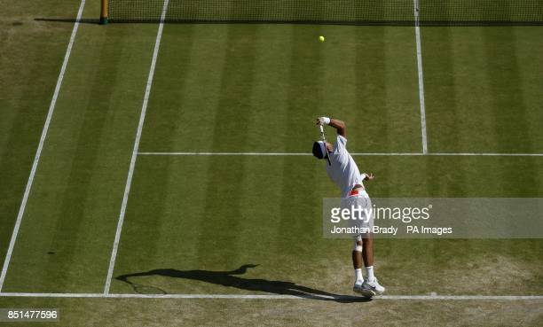 Argentina's Juan Martin Del Potro in action against Italy's Andreas Seppi during day seven of the Wimbledon Championships at The All England Lawn...