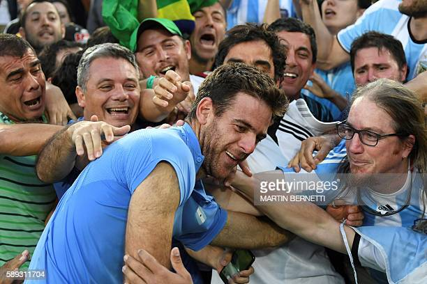 TOPSHOT Argentina's Juan Martin Del Potro is congratulated by fans after winning the men's singles semifinal tennis match against Spain's Rafael...