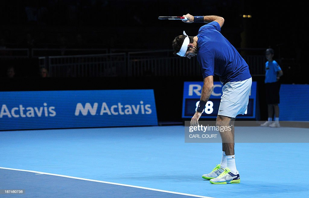 Argentina's Juan Martin Del Potro reacts after netting a return to lose a point against Switzerland's Roger Federer during their group B singles match in the round robin stage on the sixth day of the ATP World Tour Finals tennis tournament in London on November 9, 2013.